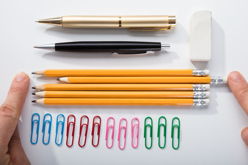 Person Arranging The Pencils On White Background