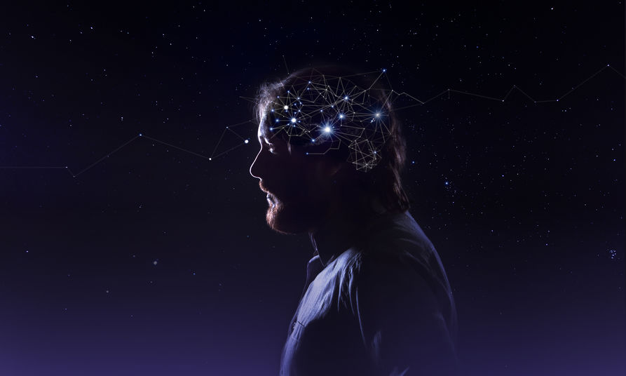 Profile of a bearded man head with  symbol neurons in brain. Thinking like stars, the cosmos inside human, background night sky